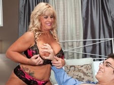 The 51-year-old cougar takes a 21-year-old jock in her ass